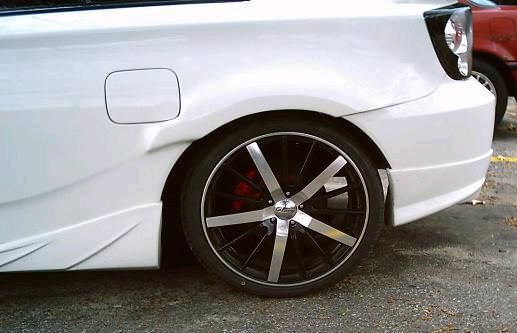 1953538415-rear back black rims.JPG